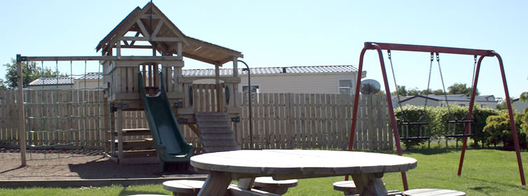 Kids Play Park with slide, swings and picnic table