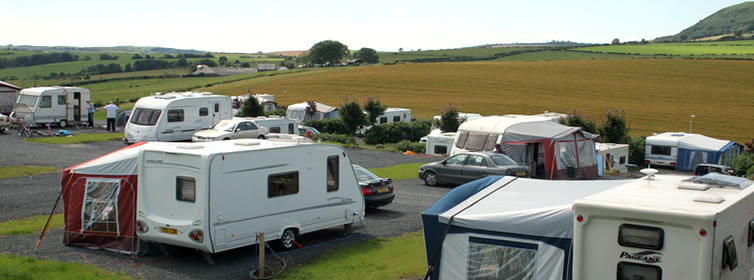 View over the touring caravans towards Mochrum Hill
