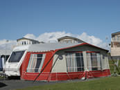 Touring caravan with awning at The Ranch, Maybole