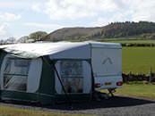 Touring caravan overlooking Mochrum Hill at The Ranch Holiday Park, Maybole